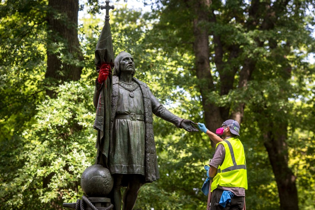 A worker removing the red paint from the hand of a Christopher Columbus statue in Central Park on Tuesday. Statues of the 15th-century explorer have come under scrutiny amid a larger debate about monuments to controversial historical figures. Credit: Dave Sanders for The New York Times. Retrieved from: https://www.nytimes.com/2017/09/12/nyregion/christopher-columbus-statue-central-park-vandalized.html